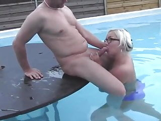 Curvy milf amateur with glasses fucks guy at pool party