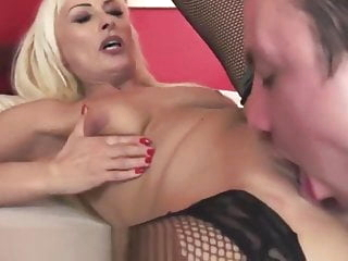 Busty gilf in stockings gets jizzed in mouth