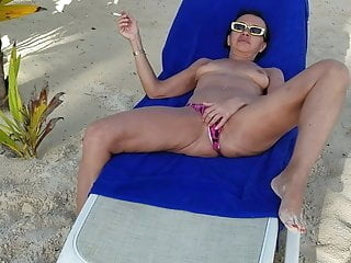 vacation 2019. hot milf is playing and stripping on a beach